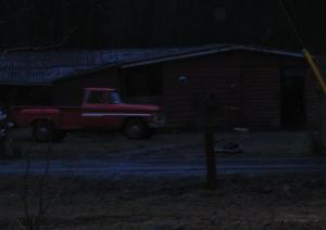 bellas-truck-and-jakes-garage-at-night