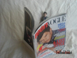 E.C. Reading Teen Vogue with Taylor Lautner on the cover