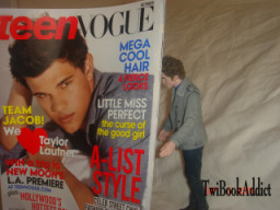 E.C. Reading Teen Vogue with Taylor Lautner on the cover2