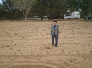 Edward standing in the sand