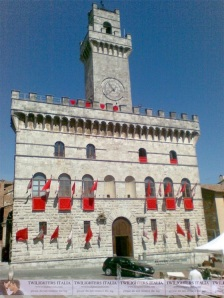 Monteoulciano Clock Tower Red Flags